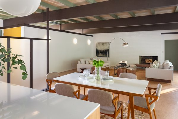 The open-plan dining and living areas, awash in natural light.