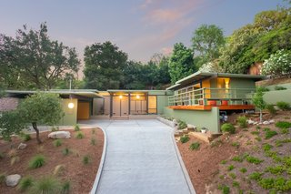HabHouse discovered that the home originally featured an earthy color palette of browns, grays, and greens. The home's current colors are inspired by another Straub design, The Thompson House on Poppy Peak Street in Pasadena.