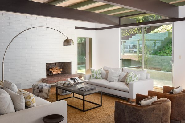 The authenticity of the home is thanks to a renovation that stayed true to Straub's vision. The open-plan living space features a fireplace and access to the backyard to effortlessly enjoy indoor-outdoor living.