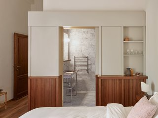 The ensuite bathrooms in the Superior Fattoria rooms are finished with local Carrara marble and custom-made ornamental stainless steel vanities.
