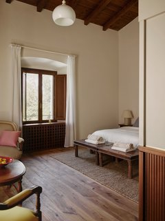 """Hesselbrand, """"concealed the necessities required in a modern hotel without jeopardizing the  simplicity and spaciousness of the existing building."""""""