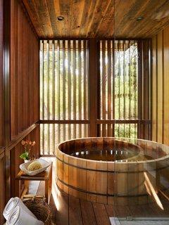 The master bath includes an envy-worthy cedar soaking tub from Roberts Hot Tubs.