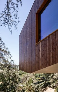 The home cantilevers over the hillside.