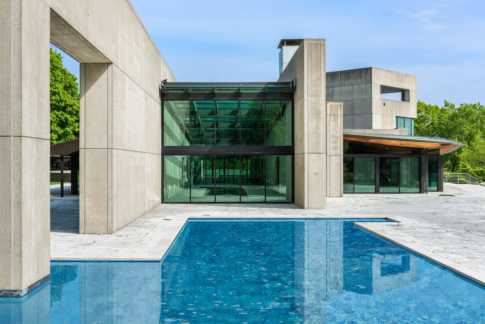 "There are two heated swimming pools: inside and out. The present owner completely refurbished both pools and updated the glass which covers the perimeter, helping to bring the home to ""even better than original"" condition."