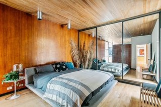 The wood paneling in the master bedroom is original as is the tongue and groove ceiling. The master is the only room in the house without a connection to the outdoors.