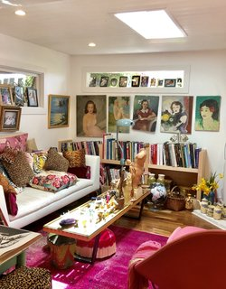 The bright pink and leopard print furnishings are reminiscent of Betsey's clothing line.