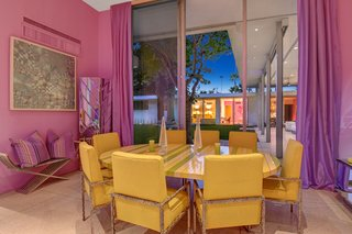 The purple formal dining room enjoys high ceilings and sliding doors.