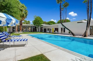 """The home has always had two pools: the large """"summer"""" pool outdoors has a lounge area that can be accessed via the oversized glass sliders in the living room. The """"winter"""" pool is located indoors."""