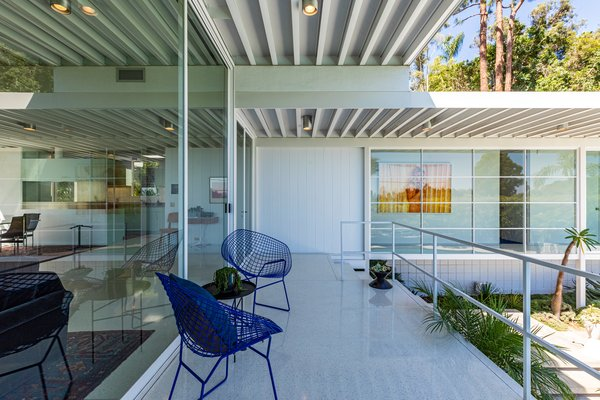 A deck just off the living space overlooks the pool and provides a comfortable shaded area to enjoy the outdoors.