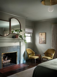 In addition to adding a master bath where the covered balcony had been, JHID gave the master bedroom a  moody green hue and a distinctive sense of style.