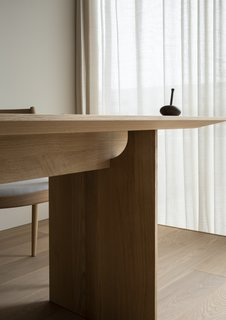 A negative space in this table's joinery allows light to shine through.