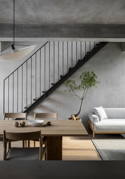 """The Kinuta A-DT01 dining table was inspired by """"the crude beauty and roughness of the demolished Kinuta apartment interiors prior to their restoration."""" The structure of the table is meant to reflect the apartments' geometric design."""