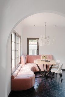 Síol Studios renovated a 1920s Spanish Colonial-style home as an L.A. getaway for a creative couple. The designers prioritized keeping the original charm of the home while updating it to accommodate an indoor/outdoor lifestyle. Each element in the home is a statement piece, particularly the custom-designed curving pink banquette. Upholstered in a durable outdoor-grade fabric, the seat is not only beautiful, but resilient against spills and wet swimsuits.