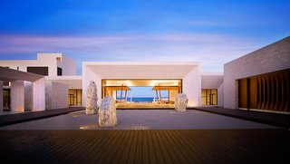"""The dramatic entry features a stone-framed ocean view that creates a """"portal to the Pacific"""" and a zen rock garden designed by WATG and David O. Design."""