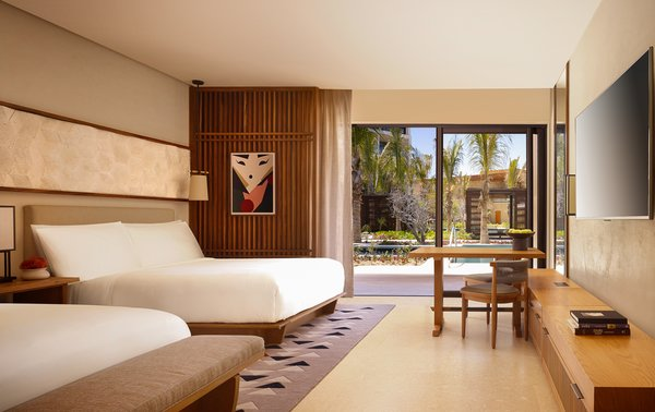 The guest rooms mix contemporary Japanese minimalism with locally sourced Mexican materials and finishes. The millwork is all Parota wood.
