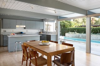 The dining area overlooks the pool.