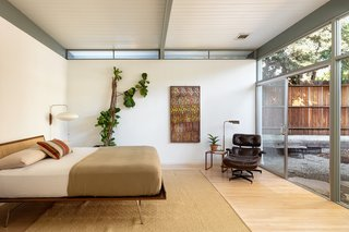 The master bedroom has 10-foot ceilings and clerestory windows.