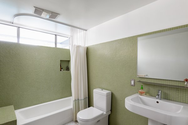 The bathrooms have been updated but still maintain a distinct midcentury vibe.
