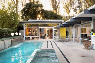 The stunning midcentury home is sited around a pool—a 2005 addition that looks like it has always been there.