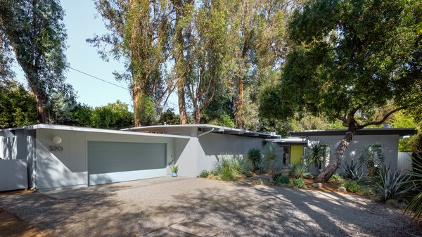 The low profile home boasts clean midcentury lines.