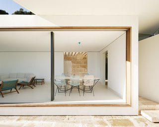 """A spectacular view of the bay is framed by """"infinity windows"""" in the living/dining room."""