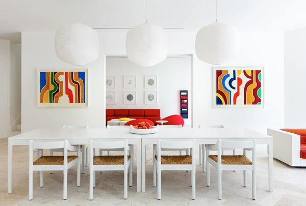 Perry painted the walls white to serve as a blank canvas for her furnishings and art.
