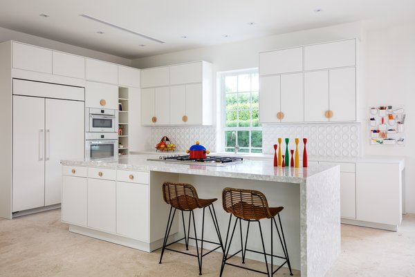 """For this home, I took down the walls, which closed off the kitchen and dining areas, and magically the sunshine and palm trees appeared,"" Perry explains of her Pop Art-inspired renovation."
