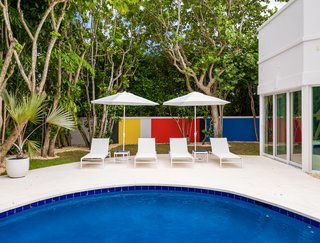 The pool has a Mondrian-inspired backdrop.