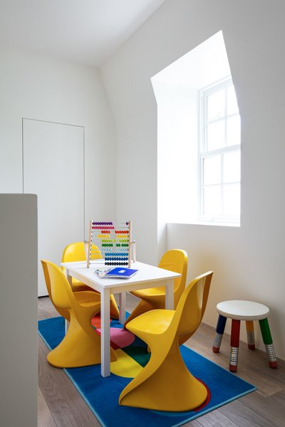 The children's play space has bold yellow Panton junior chairs.