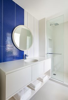 Le Corbusier tiles in a deep blue make a statement in the children's bathroom.