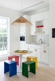"""Perry also cites the location as having helped set the tone for the project. """"For Palm Beach, there was a simple equation: Sunshine + Palm Trees = A happy colorful home,"""" Perry explains."""
