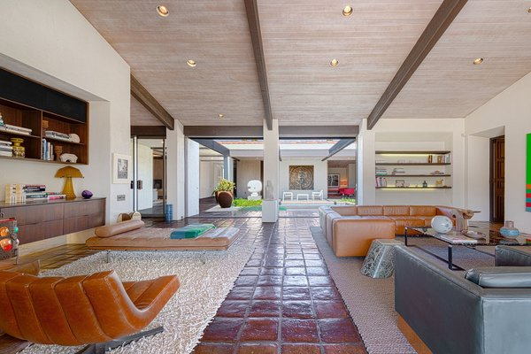 The expansive living space is bright and airy and opens to the central courtyard.