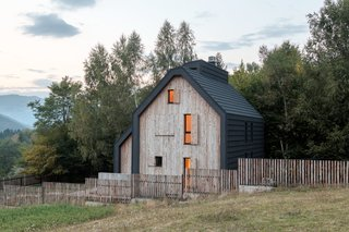 """Inspired by a haystack, Chalet Jelovac was designed to have a """"good visual, spiritual, and physical connection"""" with its natural surroundings."""