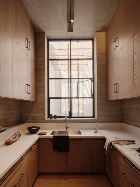 The kitchen is tight, but vertical cabinetry provides plenty of storage space.
