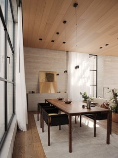 The walnut dining table and custom solid oak chairs are by Atra Form. The juxtaposition of rustic board-formed concrete with luxe furnishings gives depth to the interiors.