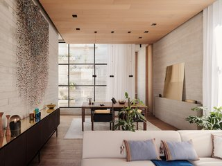 The living room transitions into the dining room, which looks out onto another light well.