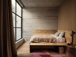 The second bedroom has a bespoke, built-in bed by Altra Form.
