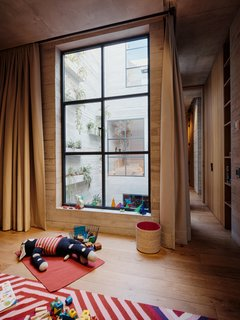 The children's room overlooks the light well with planters.