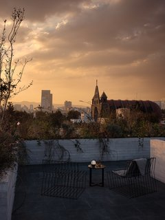 The view of the nearby Parroquia de San Agustín and the dense urban skyline.