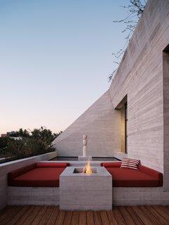 The rooftop deck features Tezontle Studio's sculpture Torso Volcanico.