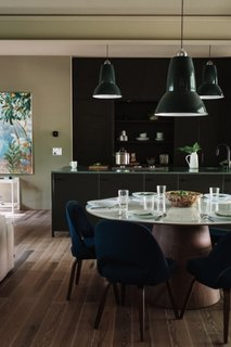 The Winston Dining Table is by Rove Concepts. The Giant Pendants over the kitchen island and dining table are from Anglepoise.