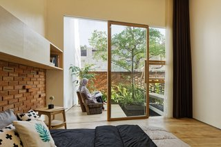 A sliding door provides access to the private garden from the master bedroom on the lower level.