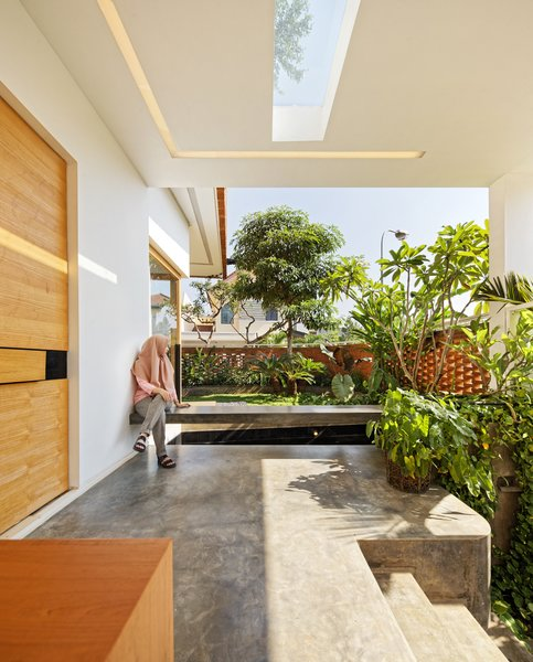A fish pond creates a microclimate to help naturally cool the 3,326-square-foot house.