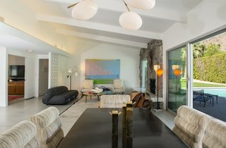 The living space has been painted white and has a bright and airy feel.