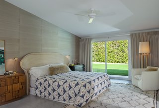 The master bedroom features large glass sliders that lead outdoors.