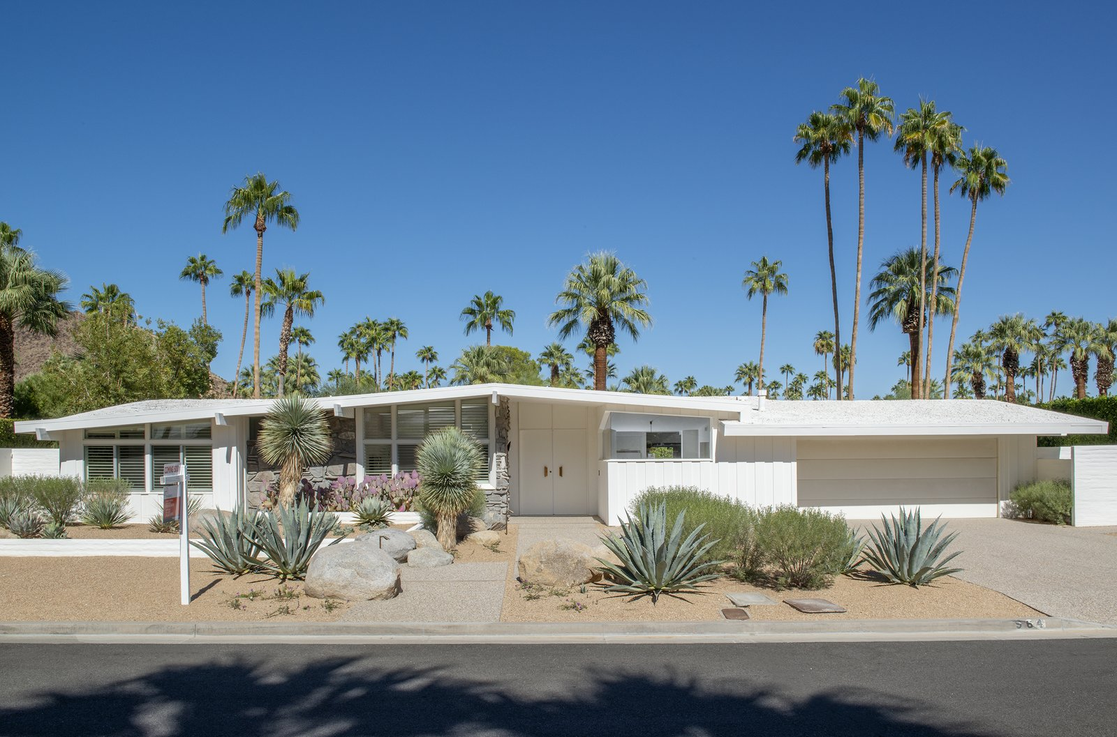 The elongated midcentury facade of 946 W. Ceres Road is classic Palm Springs and features beautiful native landscaping by a local landscape architect.