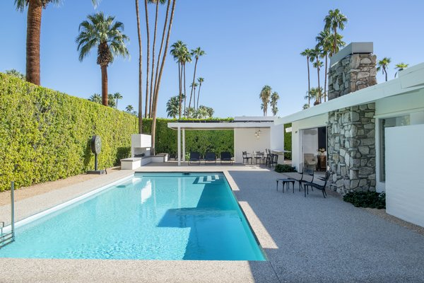 The backyard has been updated with a new pool area that includes a spa and decking, plus a  cabana and an outdoor shower. There is also an outdoor fireplace by the lounge area, perfect for entertaining on cool desert nights.