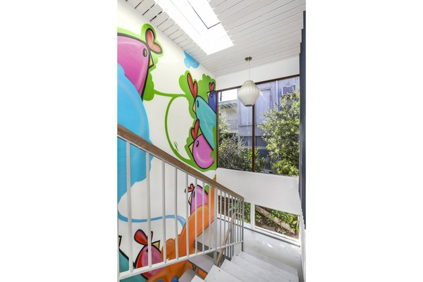 A full-height mural entitled Cachickens by Guatemalan muralist Caché adorns the interior stairwell.