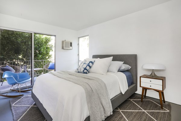 The master bedroom features sliding glass doors which lead to a second balcony.