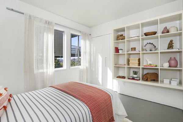 The third bedroom conveniently features built-in bookshelves.